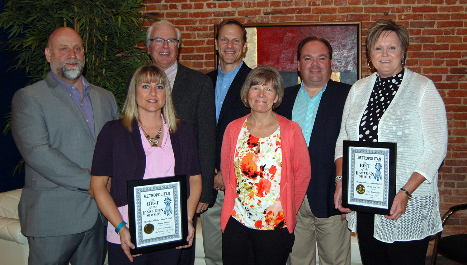"""The Sharp Energy team accepts two awards for """"Best Gas Company"""" at Metropolitan Magazine's Best of the Eastern Shore gala in Salisbury, Maryland"""