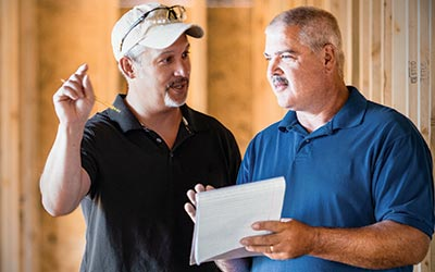 Builders- two men discussing a contract